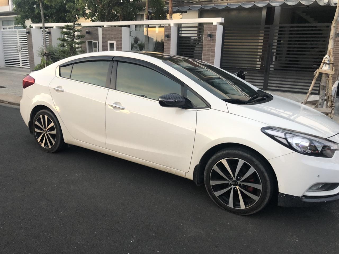 Bán Kia K3 1.6AT màu trắng số tự động sản xuất 2014 biển tỉnh đi 48000km