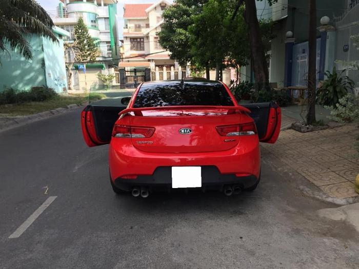 cần bán cọp Cerato 2011, số tự động, 2 cửa màu đỏ, còn mới tinh. 3