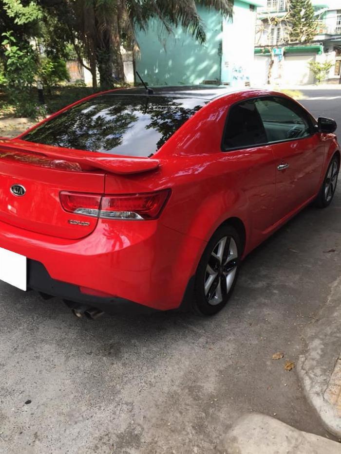 cần bán cọp Cerato 2011, số tự động, 2 cửa màu đỏ, còn mới tinh. 5