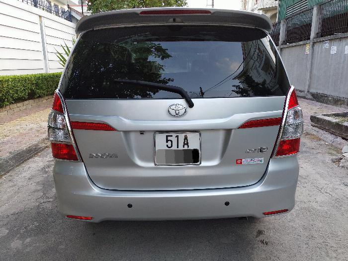 Gia đình cần bán xe innova E 2014 màu bạc 7
