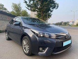 Tôi cần bán Toyota Altis đời 2014, phiên bản 1.8, số tự động, phom mới, màu xám xanh